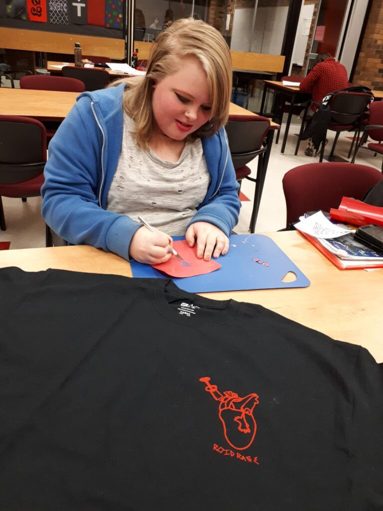Teen working on the PoverTEES Project