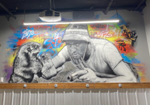 Photo of mural inside Longshotz Golf. Photo submitted by Baylee Toshack.