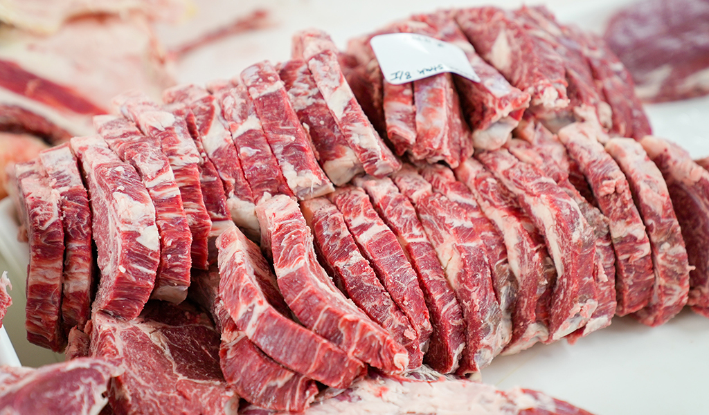 cuts of veal stacked next to eachother