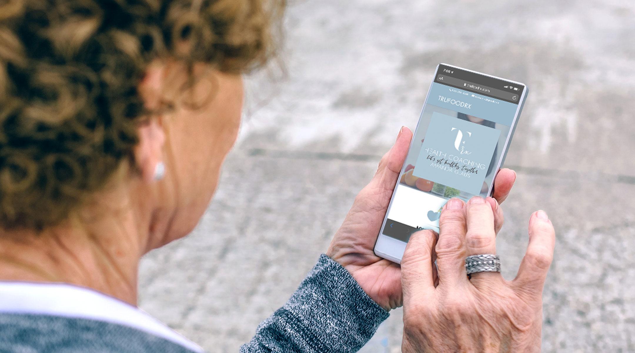 Senior athlete looking at mobile website on phone