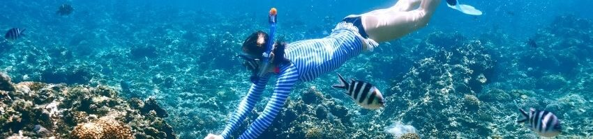 A woman dives deep to a beautiful reef in Florida.