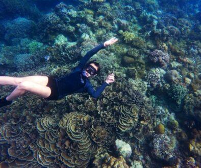 Snorkel expert looking at the underwater camera