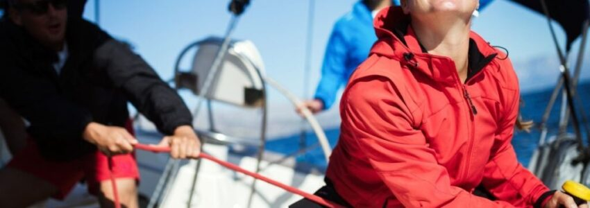 A group of adult people wearing a gears for sailing