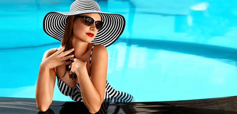 woman sunbathing by pool Bellava MedAesthetics and Plastic Surgery Center in Bedford Hills, NY