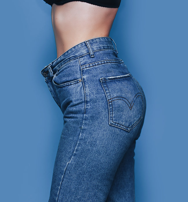 woman in jeans Bellava MedAesthetics and Plastic Surgery Center in Bedford Hills, NY