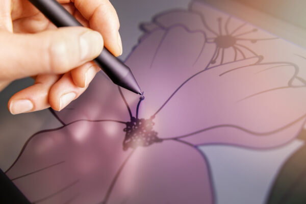 vector art - closeup of hand with digital pen drawing flower illustration on graphics tablet