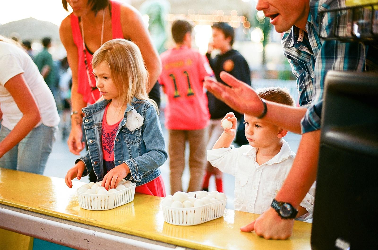 Family photo fun at the San Diego County Fair by family photographer Lauren Nygard