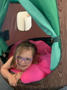 Sensory spaces girl in tent laying down