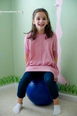 girl on sensory yoga ball