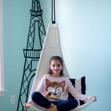 Sensory room girl in swing