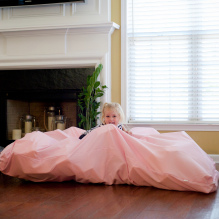 sensory room girl with pink blanket