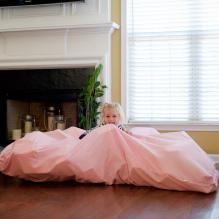 sensory room girl with pink blanket