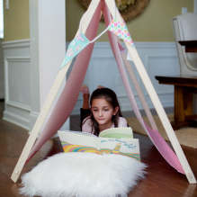 Sensory spaces girl reading book in tent