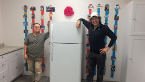 Time Burris, Construction Project Manager and Jesus Garcia, Winchester Community Action Board member completed the installation of refrigeration and cabinetry.