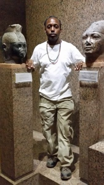 Standing between the busts of Taharka, left, and Shabaka, right. 25th Dynasty - Nubian Museum