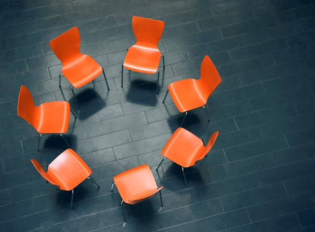 Group Therapy Orange Chairs in a Circle
