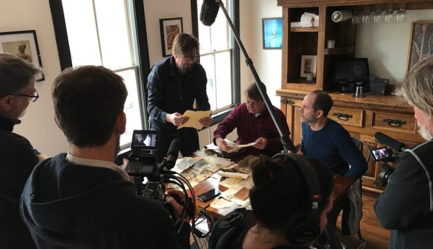 Rocket to Venus co-owners Geoff Danek and Brian Carey meet with Lance Barley, Robert Condit's great-nephew and pour through documents about the mysterious rocket. Photo courtesy of Urban Goat Films.