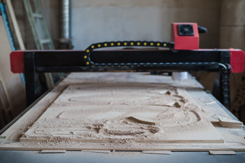 Automated cutting CNC machine in wood work shop