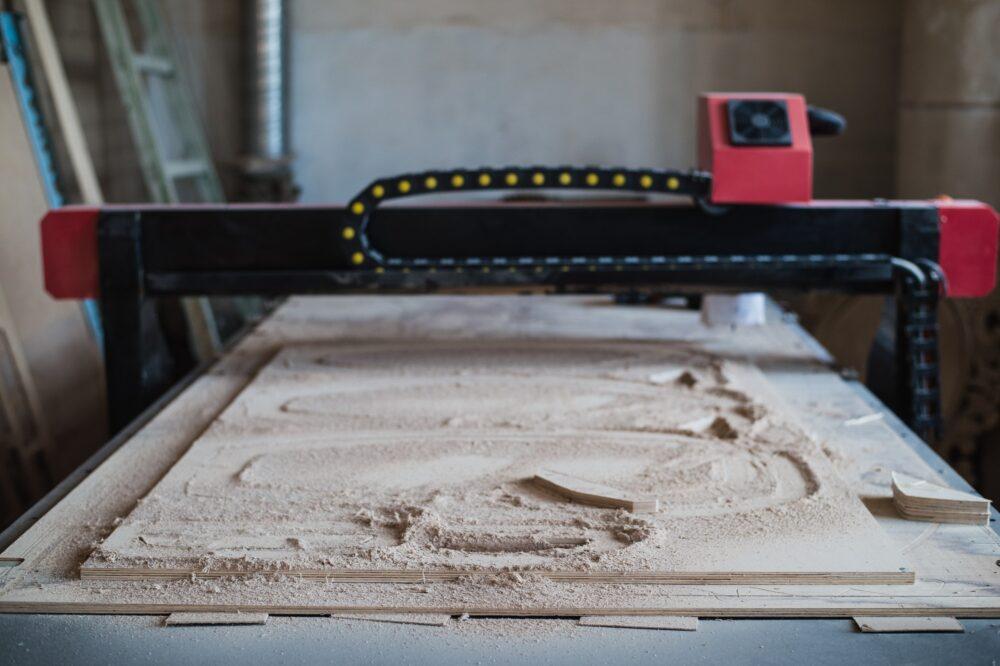Automated cutting CNC machine in wood work shop