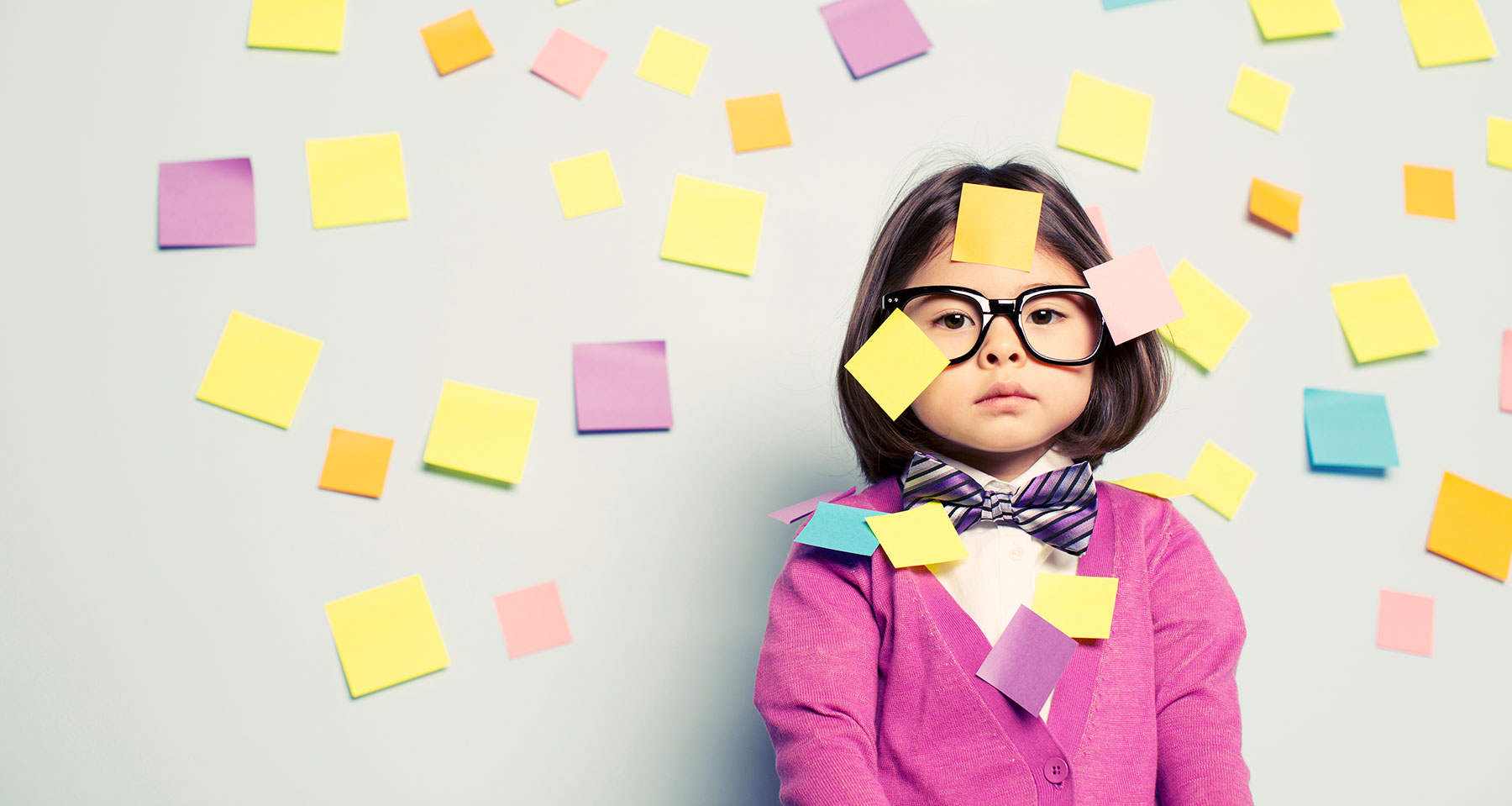 studious girl overwhelmed with post-it notes
