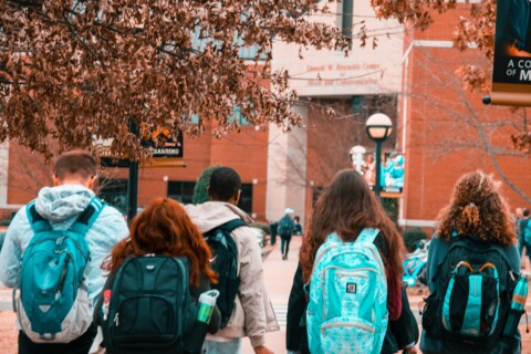 Students with backpacks walking to school