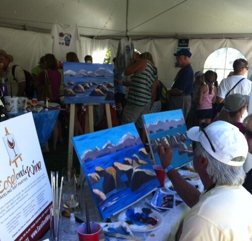 An Easel and Wine Art Party Demonstration at the Village Fair during Red, White and Tahoe Blue