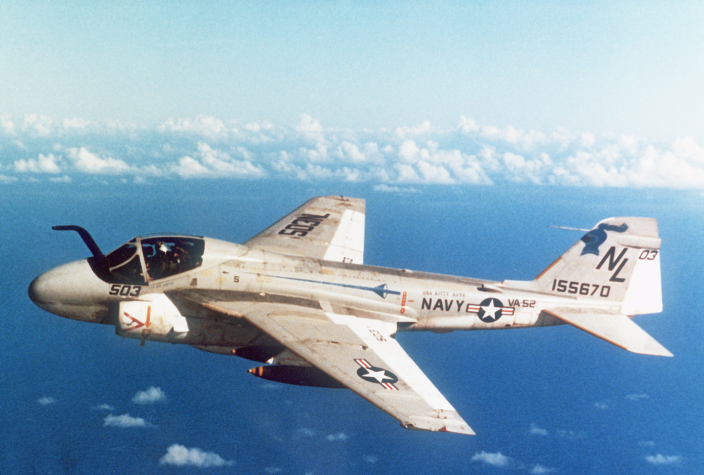 Left side air-to-air view of an A-6E Intruder aircraft from Medium Attack Squadron 52 (VA-52).