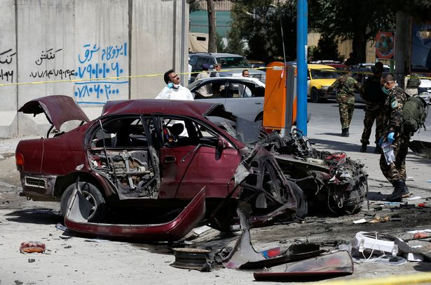 Afghan-personnel-investigate-at-the-site-of-a-bomb-blast-near-the-US-Embassy-in-Kabul