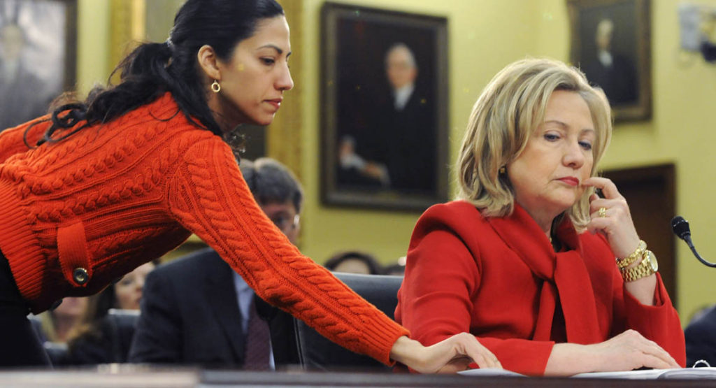WASHINGTON, DC - MARCH 10: U.S. Secretary of State Hillary Clinton (R) receives a note from her aide Huma Abedin (L) as she testifies about the State Department's FY2012 budget during a hearing of the State, Foreign Operations and Related Programs Subcommittee of the House Appropriations Committee in the Rayburn House Office Building on March 10, 2011 in Washington, DC. Secretary Clinton has recently warned that proposed budget cuts would have a negative effect on U.S. national security policy. (Photo by Jonathan Ernst/Getty Images)