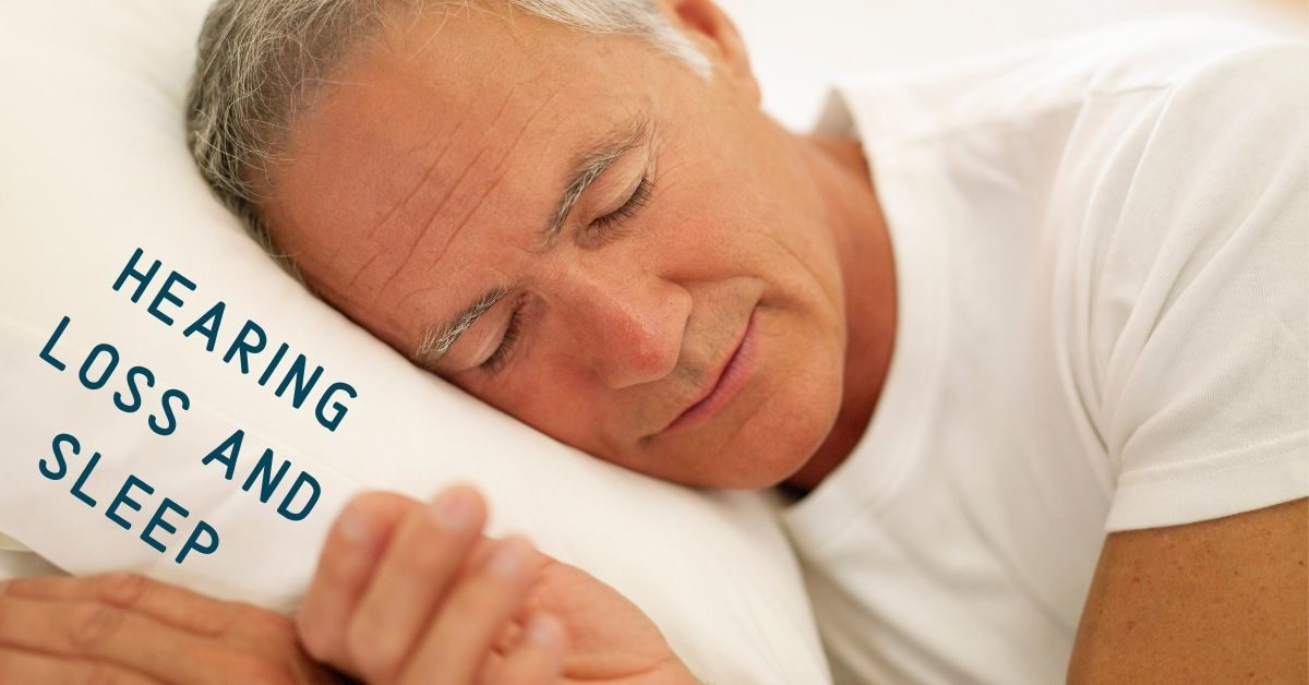 An older man sleeping