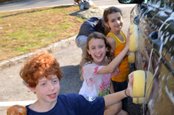 Youngsters step up to help wash cars!