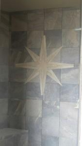 R&R Homes 4349 Yarrow Lane master bath poured shower floor - DalTile Ayers Rock porcelain tile with custom star design.
