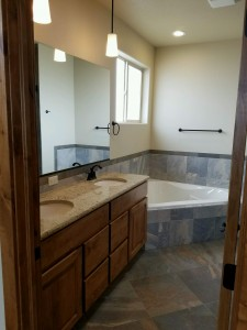 4349 Yarrow Lane master bathroom soaker tub and 2 sinks. Porcelain tile and upgraded 3cm granite countertop with under mount sinks.