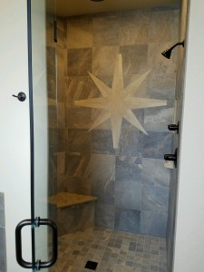 4349 Yarrow Lane master walk-in shower. Porcelain tile with granite bench and poured shower floor. Built-in niches for storage. Regular shower head and rainfall head in ceiling with diverter to control them.