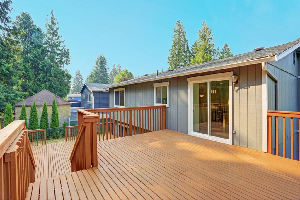 homeguide upper level redwood deck with railings