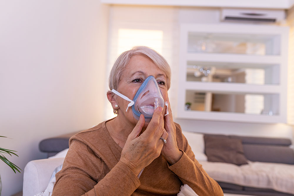 Sick Elderly Woman Breathing Oxygen