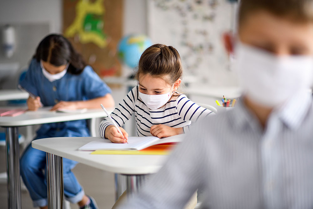 Children with Face Mask On to Protect from Covid