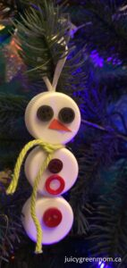 snowman ornament from upcycled caps and buttons