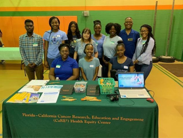 CaRE2 Summer Undergraduate Trainees assisting with CaRE2 sponsored community events with Dr. Suthers and Dr. Redda at FAMU