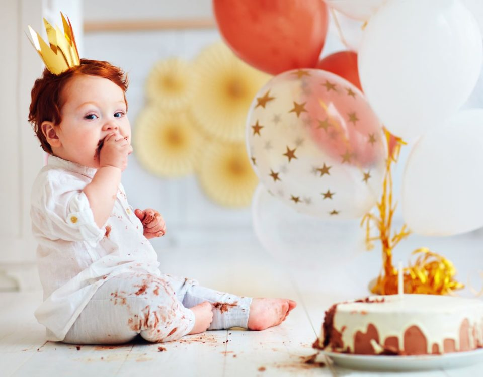 Party Rentals in Miami, FL-Funny infant baby boy tasting his 1st birthday cake