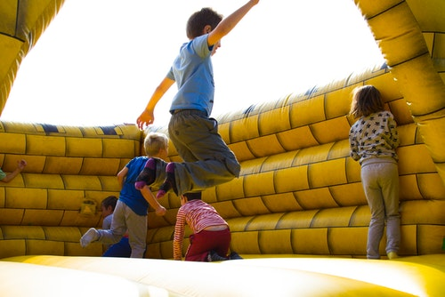 action-activity-boys jumping on a inflatable