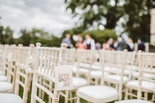 Flower centerpieces and silver Chiavari chairs