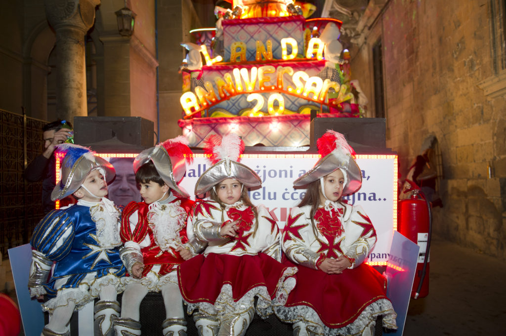 Children riding on float for Canivale