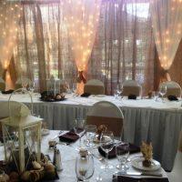 Burlap, twinkle lights by designer weddings