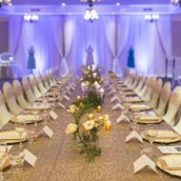ivory fabric backdrop with gold sequin by Designer Weddings in Victoria BC