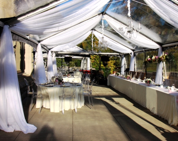 Tent leg draping - clear tent - by Designer Weddings