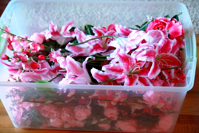 bin of silk flowers by Designer Weddings