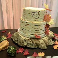 Wooden cake stand by Designer Weddings