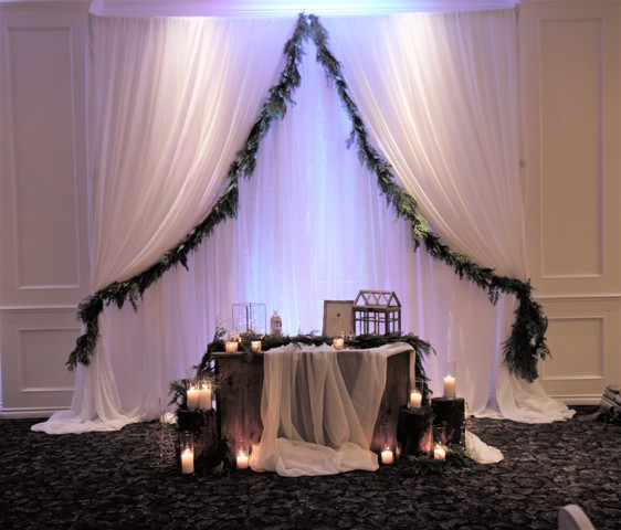 greenery backdrop with fabric panels