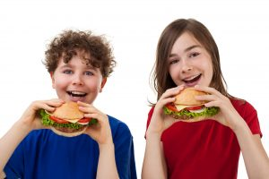 Kids eating burgers